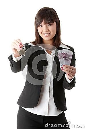 Free Beautiful Woman Holding Keys And Moneys Royalty Free Stock Image - 12084956