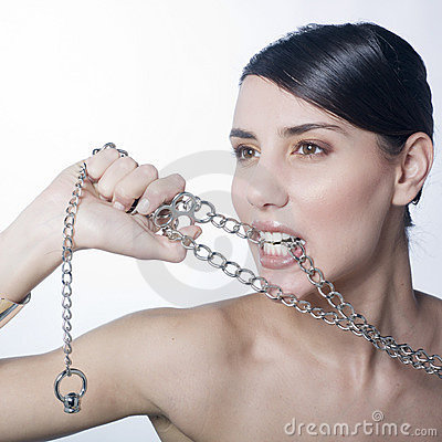 Beautiful woman holding metallic chain