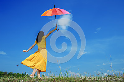 Beautiful woman holding multicolored umbrella