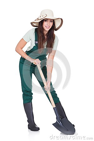Free Beautiful Woman Holding Plant And Gardening Shovel Royalty Free Stock Photography - 29081807