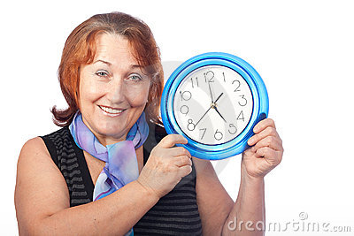 Beautiful woman holding a round clock