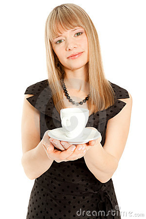 Beautiful woman holding white cup (focus on a cup)