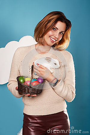 Free Beautiful Woman Holding White Little Easter Bunny Basked Eggs Royalty Free Stock Images - 48265629