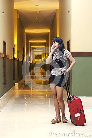 Beautiful woman in hotel corridor
