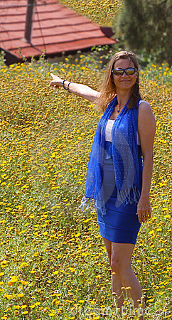 Beautiful woman with house in a flower field