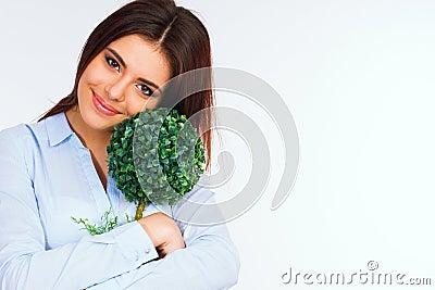 Beautiful woman hugging small green tree