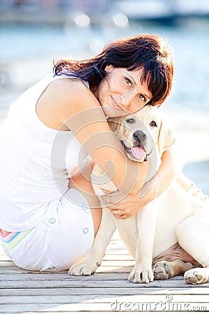 Beautiful woman hugs her dog