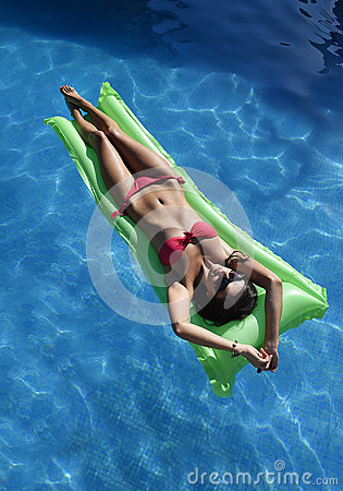 Free Beautiful Woman In Bikini Lying Relax On Float Airbed At Vacation Hotel Resort Swimming Pool Stock Photos - 76753573