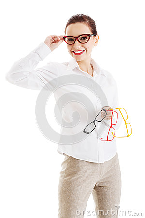 Free Beautiful Woman In Eyeglasses Holding Three Different Pair Of Ey Stock Photos - 36540363