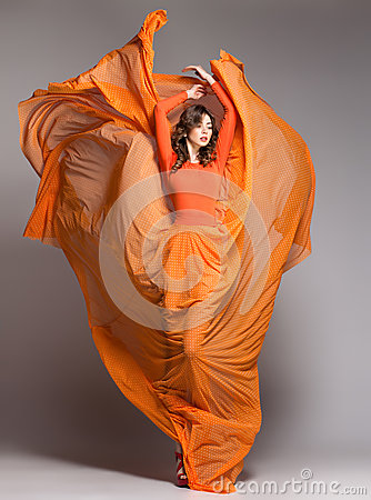 Free Beautiful Woman In Long Orange Dress Posing Dramatic Royalty Free Stock Photo - 29594745