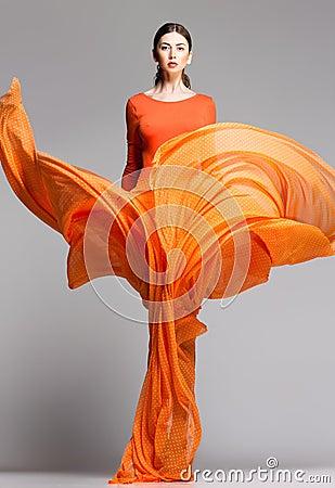 Free Beautiful Woman In Long Orange Dress Posing Dramatic Stock Photos - 29594773
