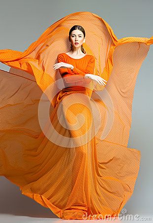 Free Beautiful Woman In Long Orange Dress Posing Dramatic Royalty Free Stock Images - 29594779