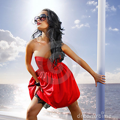Free Beautiful Woman In Red Dress On The Shore Stock Photo - 11108890