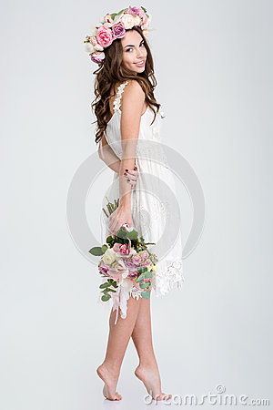 Free Beautiful Woman In White Dress And Roses Wreath Standing Barefoot Stock Image - 65296581