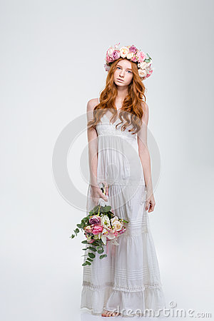 Free Beautiful Woman In Wreath Standing And Holding Bouquet Of Flowers Royalty Free Stock Images - 64980649