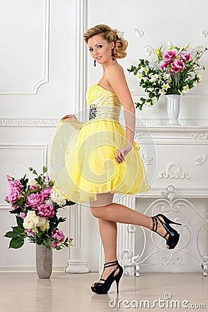 Free Beautiful Woman In Yellow Dress In Luxury Studio. Royalty Free Stock Image - 32468496