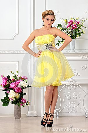 Free Beautiful Woman In Yellow Dress In Luxury Studio. Royalty Free Stock Photo - 32468505