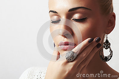 Beautiful woman.Jewelry and Beauty.girl.ornamentation.liquid sand manicure.hairless