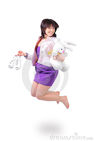 Beautiful  woman jumping in joy with plush rabbit
