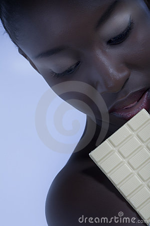 Beautiful woman with a large bar of choccolate