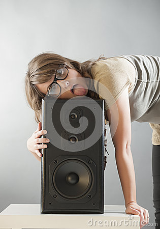 Beautiful woman laying on the big speaker