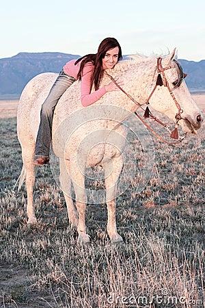 Beautiful Woman Laying on Horse