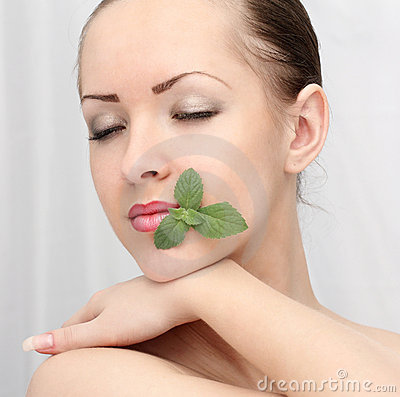 Beautiful woman with leaf