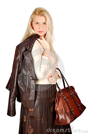 Beautiful woman with leather jacket and bag posing