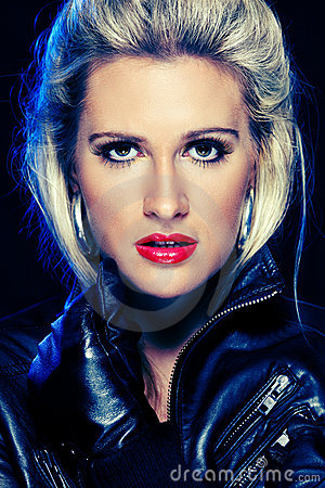 Beautiful woman in leather jacket. Retouched
