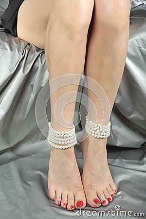 Beautiful woman   legs over satin fabric