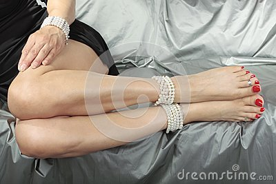 Beautiful woman   legs over satin fabric