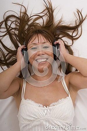 Beautiful woman listens music