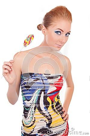 Beautiful woman with lollipop