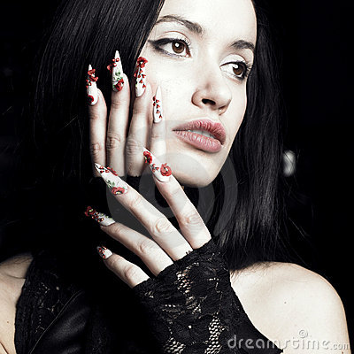 Beautiful woman with long, designer nails