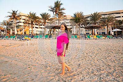 Beautiful woman with long hair on background of beach. Persian Gulf ,Dubai.Tanning girl near ocean