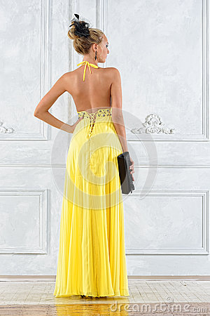 Beautiful woman in a long yellow dress.