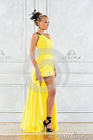 Beautiful woman in a long yellow dress.