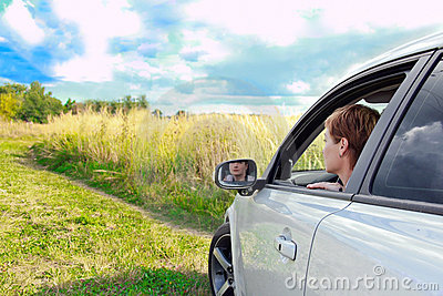 Beautiful woman looking from the car