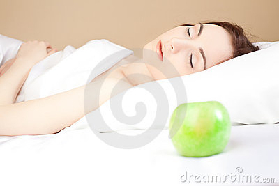 Beautiful woman lsleeping in bed (focus on woman)