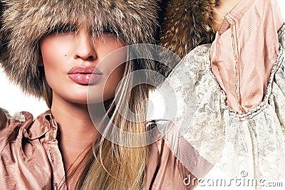 Beautiful woman in luxurious clothing