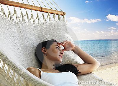 Beautiful woman lying in hammock