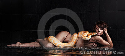 Beautiful woman lying with Python