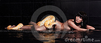 Beautiful woman lying with Python