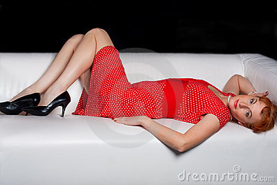 The beautiful woman lying on a sofa