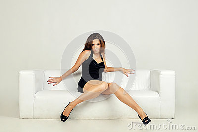 Beautiful woman lying on a white sofa,  on