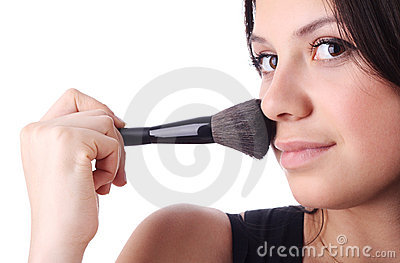 Beautiful woman with a make-up brush. Isolated