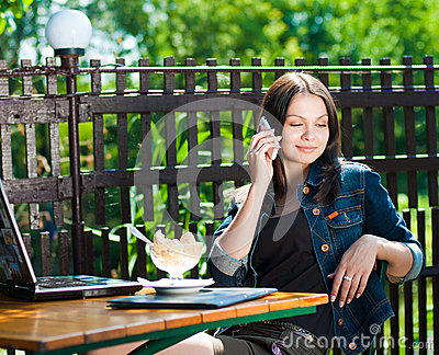 Beautiful woman on mobile phone in cafe