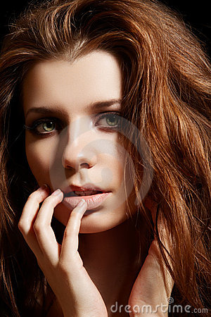 Beautiful woman model with disheveled volume hair