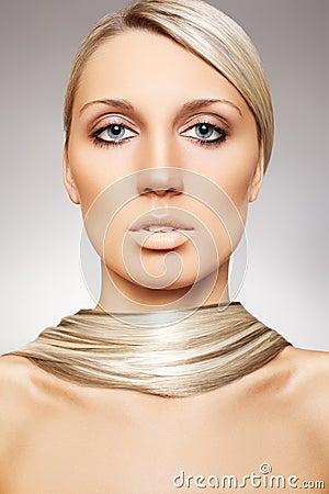 Beautiful woman model. Long blond shiny hair style