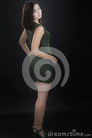 Beautiful woman model posing in elegant dress  on black